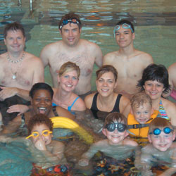Adults and children in the pool
