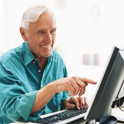 Man with hemophilia on computer