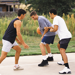 Wearing proper shoes while playing basketball