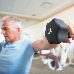 Man lifting hand weights