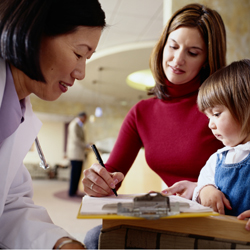 Doctor with mom and little girl at a hemophilia treatment center