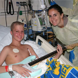 Vanya Green and a teenage boy with guitar for music therapy