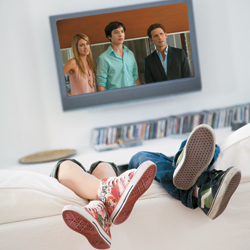 Two teenagers watch the TV show Royal Pains.